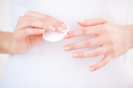 nail care: Nail care. Close-up of woman cleaning nails with cotton pad Stock Photo