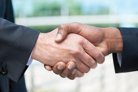 Handshake business: Business handshake. Close-up of business men shaking hands Stock Photo