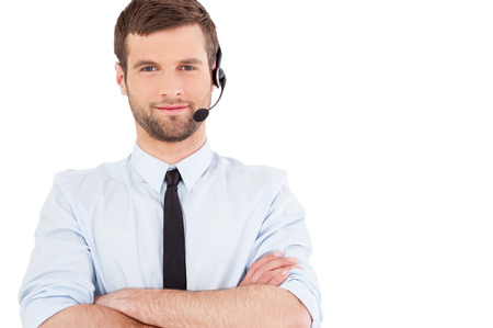 call center people in isolated: Male operator. Handsome young man in formalwear and headset looking at camera and smiling while standing isolated on white background