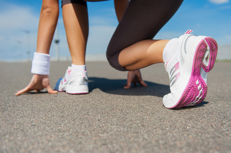 getting ready: Getting ready to run.  Close-up image of woman in sports shoes standing in starting line