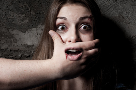 No  Terrified young woman with hand covering her mouth staring at camera Stock Photo