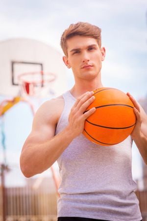 high school basketball: Basketball player. Handsome young male basketball player ready for the shot