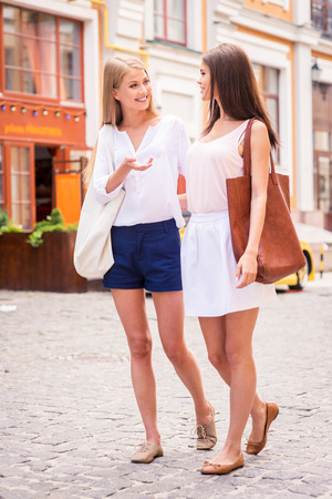 I have so much to tell you! Two beautiful young women walking along the street and talking