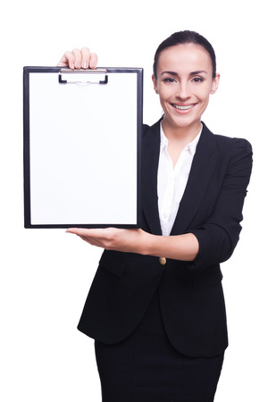 cope: Cope space on her clipboard. Businesswoman demonstrating empty paper on a clipboard Stock Photo