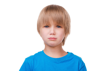 crying boy: Little boy crying. Sad little boy crying and looking at camera while standing isolated on white Stock Photo