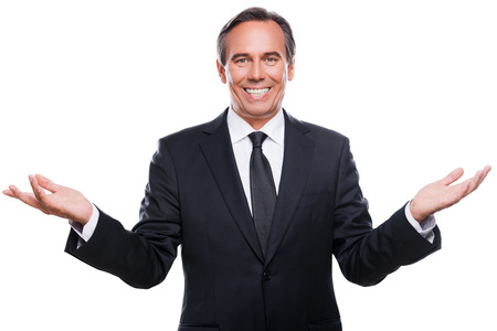 Confident business expert. Happy young man in shirt and tie gesturing and smiling while standing isolated on white background Banco de Imagens