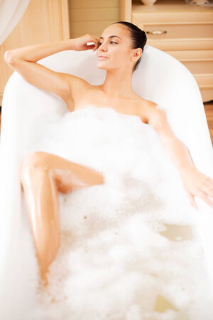 Blissful moments. Top view of attractive young woman enjoying luxurious bath  photo