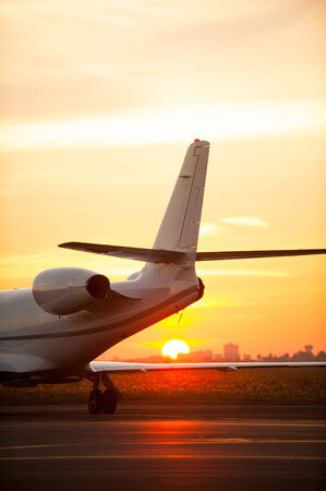 just arrived: Just arrived. Cropped image of airplane landing in airport with sunset in the background Stock Photo