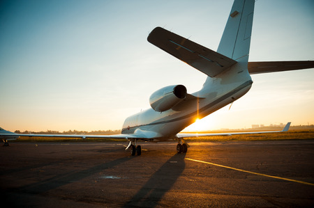 private jet: Ready to take off. Rear view of airplane taking off from airport Stock Photo