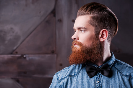 men shirt: Perfect hairstyle. Profile portrait of handsome young bearded man looking away