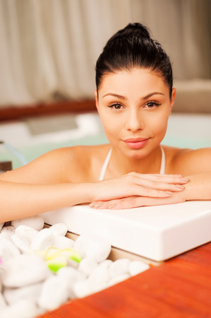 sex symbol: Relaxing in hot tub. Attractive young woman relaxing in hot tub and looking at camera Stock Photo