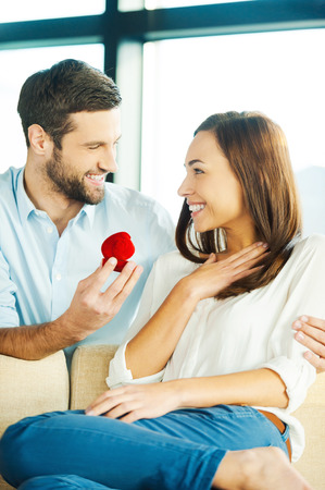 marry me: Will you marry me? Handsome young man making a proposal while giving an engagement ring to his girlfriend Stock Photo