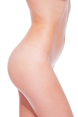 20s naked: Sexy buttocks. Close-up of young naked woman standing against white background Stock Photo