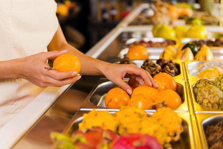 freshest: Choosing the freshest fruits. Close-up of woman choosing fruits in grocery store Stock Photo