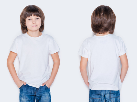 Advertising your brand. Front and rear view of little boy holding hands in pockets while standing against white background photo