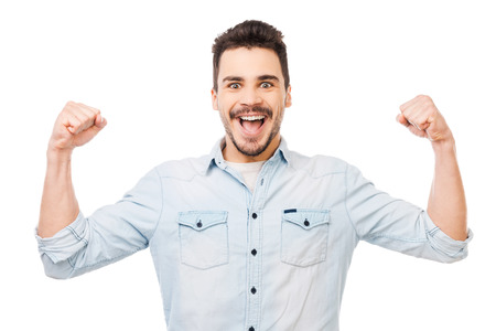 unleashed: Unleashed fun. Happy young man in shirt gesturing and smiling while standing against white background