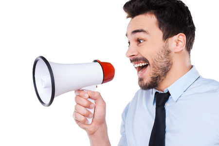 good shirt: Announcing good news. Side view of happy young man in shirt and tie holding megaphone and shouting while standing against white background