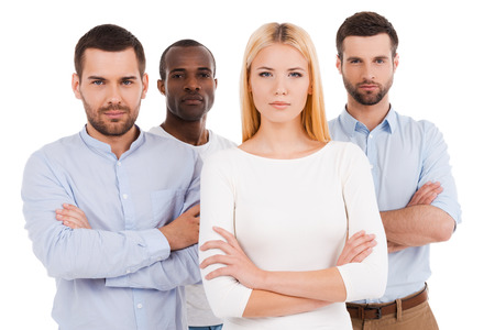 Confident business team. Four young and confident people in smart casual wear looking at camera while standing against white background Stock Photo