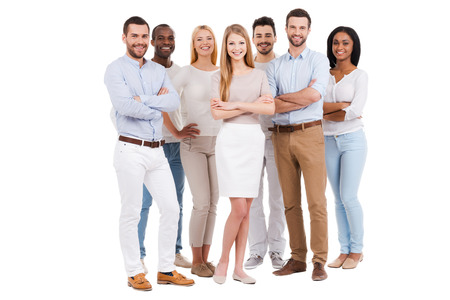 woman in white: Proud to be a team. Full length of multi-ethnic group of people in smart casual wear looking at camera and smiling while standing against white background Stock Photo