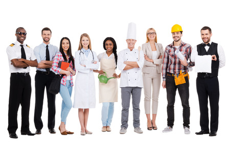office uniform: Choose your profession. Group of diverse people in different occupations standing close to each other and against white background and smiling Stock Photo