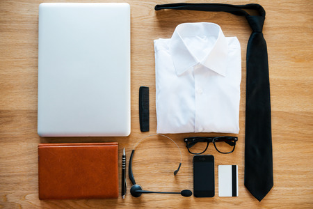 personal accessory: Business collection. Top view of clothing and diverse personal accessory for businessman laying on the wooden grain