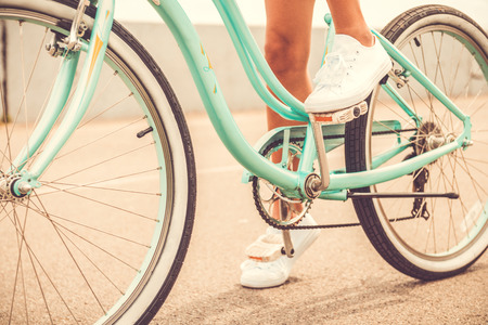 bicycle pedal: Ready to ride. Close-up of young woman holding her foot on bicycle pedal