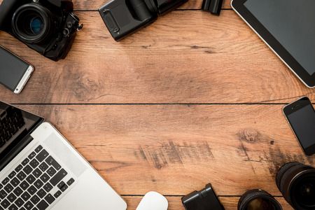 group of business people: Top view of diverse equipment for photographer laying on the wooden grain Stock Photo