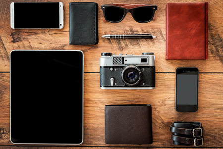 personal accessory: Interaction of retro and modern. Top view of diverse personal accessory laying on the wooden grain