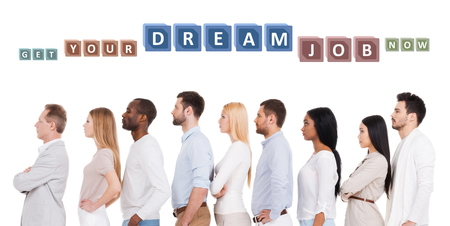 side job: Find your dream job! Side view of confident diverse group of people in smart casual wear looking away while standing in a row and against white background Stock Photo