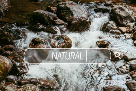 multilayered: Choose natural. Close-up of falling clean water with rocks and stones Stock Photo