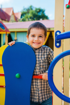 jungle gym: Time to play. Happy little boy looking and camera and smiling while having fun on jungle gym Stock Photo