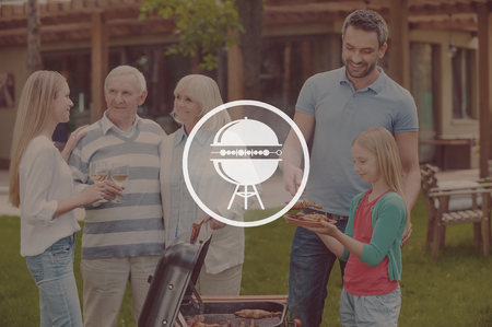 photographic effects: Family barbecue. Happy family of five people barbecuing meat on grill on the back yard Stock Photo