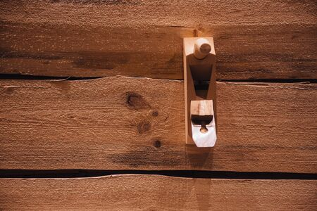 planer: Wood planer. Top view of wood planer laying on the rough wooden table