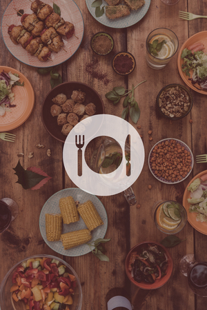 comida gourmet: Lunch time. Digitally composed picture of kitchen utensil over top view of rustic wooden table full of food and drinks Foto de archivo