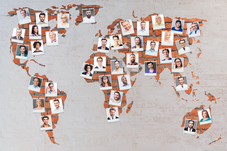 mixed age range: World population. Close-up image of brick world map with photographs of different people Stock Photo