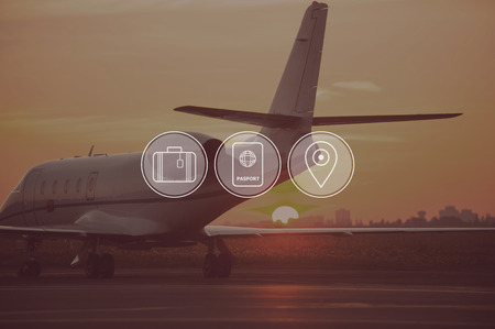 private jet: Good time for travelling. Digitally composed icon set over a picture of private jet landing in sunset