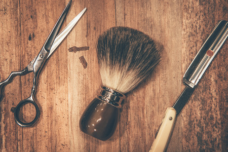 hair and beauty: Grooming tools. Top view of barbershop tools lying on the wood grain