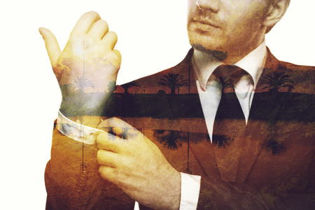 sleeve: Popping memories. Digitally composed close-up picture of young businessman adjusting his sleeve over the picture of landscape with palm trees