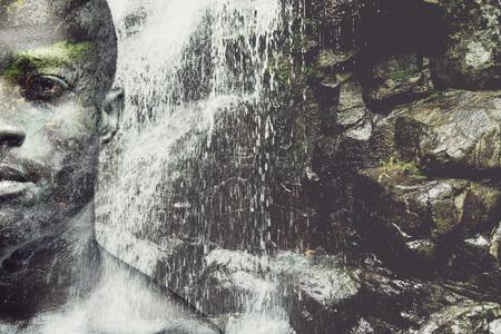 hombre cayendo: La energ�a dentro de �l. cara completa compuesta digitalmente la mitad de la imagen del hombre africano joven y guapo sobre la imagen de la cascada Foto de archivo