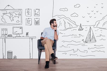 young business man: Your dreams can send you far away. Young handsome man keeping hand on chin and looking away while sitting in the chair against illustration of fjord vs. working place