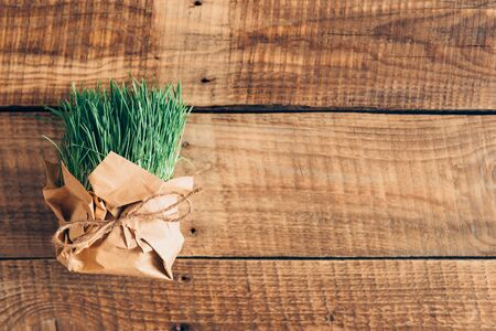 d cor: Fresh grass. Top view of grass package lying on wooden rustic table
