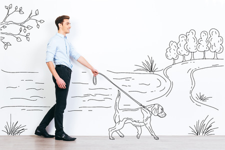 handsome young man: On walk with his dog. Handsome young man walking out his drawn dog in illustration of park