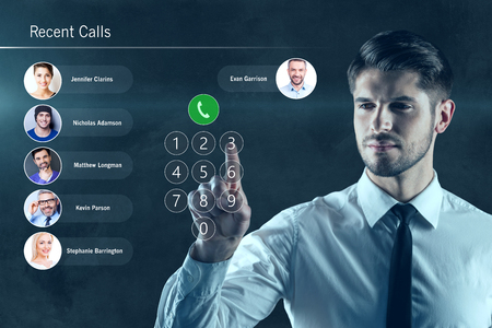 digitally generated image: New ways of communiction. Digitally generated image of man dialing number on transparent board