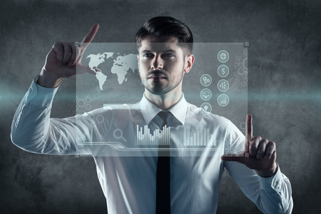 digitally generated image: Welcoming new technologies. Digitally generated image of man working on transparent wipe board Stock Photo