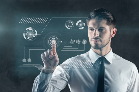 digitally generated image: Touch the future. Digitally generated image of man pushing button on transparent wipe board Stock Photo