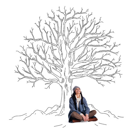 woman looking up: Beautiful winter! Beautiful young cheerful woman looking up with smile while sitting in lotus position under sketch of leafless tree Stock Photo
