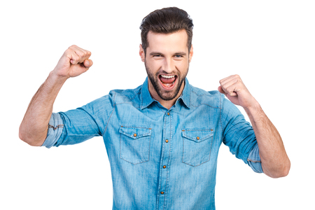only one man: Happy young handsome man gesturing and keeping mouth open while standing against white background Stock Photo