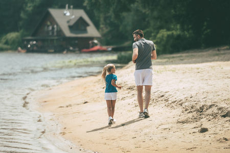 little one: Jogging, Running, Sport, One Parent, Single Father, Little Girls, Child, Offspring, Family, Father, Men, Male Beauty, Daughter, Togetherness, Two People, Sports Training, Lifestyles, Moving Activity, Action, Vitality, Motion, Leisure Activity, Sports Clot Stock Photo