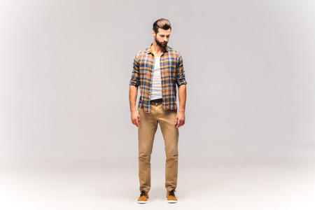 casually: Casually handsome. Full length studio shot of handsome young man in casual wear Stock Photo