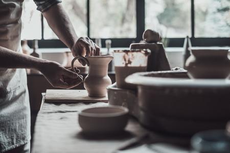 potter: Potter at work. Close-up of potter making ceramic jug on at his workshop Stock Photo